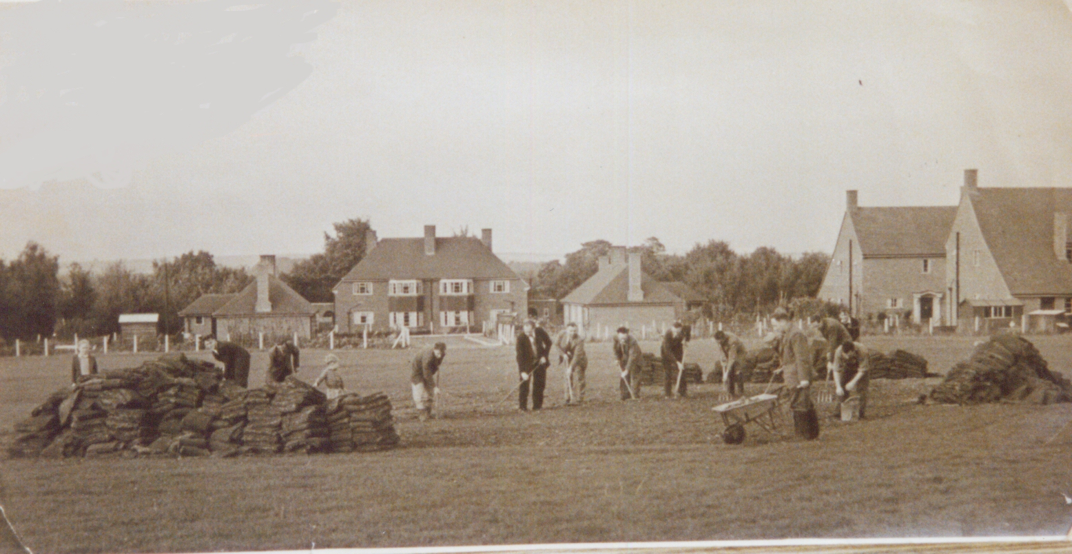 Working on the Village Sports field after it was donated to the Village