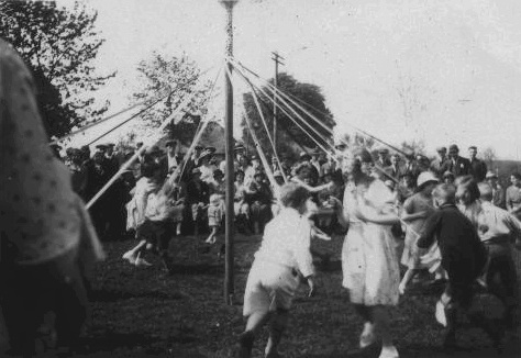 The Maypole dance at The War Memorial Hall on the occasion of King George V. Silver Jubilee.