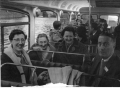 Adults and children on a school bus trip c1965