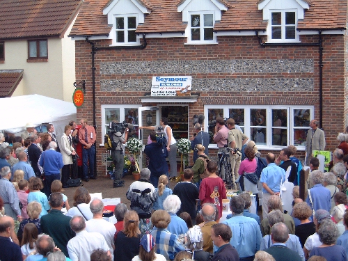 Jackie Stanton opening the Village Shop door