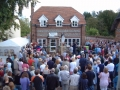 The start of the formal opening of the Village Post Office
